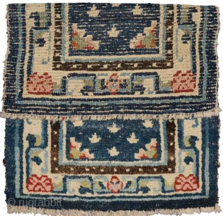 When this rug was first seen by me many many years ago it had a ragged outer blue covered felt border that showed signs of having been used as an 'above-saddle' carpet.  ...