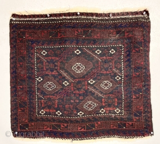 Antique Baluch bagface with an interesting older design. Fine lustrous pile with rich saturated natural color. Nice ember reds and a bit of yellow highlights. Mostly good thick pike with some brown  ...