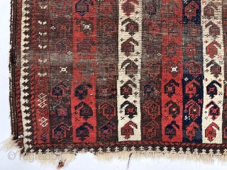 """Early Baluch rug with interesting and archaic striped or """"cane"""" design. Overall very rough with areas of foundation exposed and no pile. All natural colors including an excellent saturated red. Remnant original  ..."""