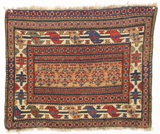 antique soumak bagface. Pretty gold ground. Unusual wide format. Good weave. All natural colors featuring nice old greens and light blues. Clean. I see a small fairly well done repair in center.  ...