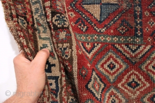 Antique caucasian mystery prayer rug with a dramatic and unusual design. Charming little rug. All good natural colors. Fair overall condition with low pile and end loss as shown. No repairs. Reasonably  ...