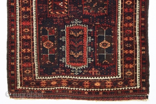 antique baluch rug with an interesting and unusual design in mostly thick high pile with a few knots of light colored silk in the border. Possibly a transitional piece with the drawing  ...