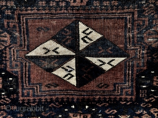 Antique large Baluch bagface with an attractive and rare design. Original selvages and remnant fancy ends. Very low pile with wear as shown. Natural colors. As found, in need of a good  ...
