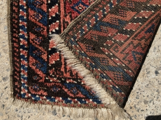 "Antique Baluch balisht with full thick pile and good natural colors. Original selvages. Reasonably clean. Nice little weaving. ca. 1900. 17"" x 35""."