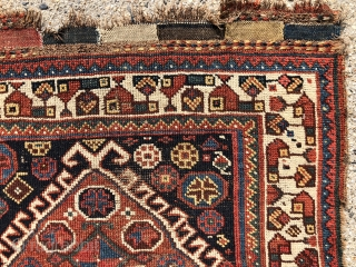 Early south Persian Khamseh bagface. Unusually spacious field and border design drawing along with an extremely supple handle indicates good age to me. Overall very low pile with wear as shown. All  ...