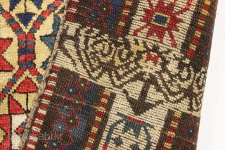 large yellow ground antique kazak rug with a unique design feature. A small ivory panel woven into the rug as shown. When i first saw the rug i was certain this was  ...