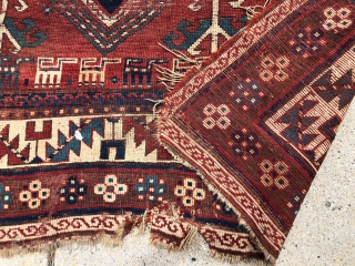 """Antique Kazak rug fragment with a charming row of animals. Some decent pile. Some wear and brown oxidation. Edges all tattered. Reasonably clean. Offered for project or pillow? 19th c. 3'3"""" x  ..."""