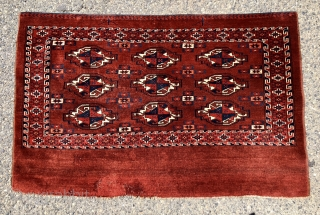 Antique yomud chuval with rich saturated natural colors, good pile and relatively spacious drawing. The elegant star minors use a very nice light blue. Overall very good condition for the age other  ...
