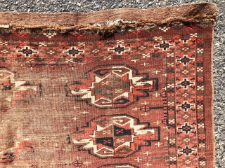 Antique turkman yomud chuval with some interesting design features but in rough condition. Large main guls and an unusual minor gul paired with an attractive skirt panel. As found this week, very  ...