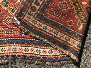 """Antique Caucasian karrabagh rug, a type often described as """"Kasim Ushak"""". This reasonably early example has the characteristic medallions and serrated leaf motifs plus many interesting tribal decorations of humans and animals.  ..."""