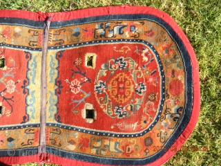 "Tibetan Under Saddle Rug 49""x26.5"".  More desirable oval shape with some signs of use. 1930s with cotton warps and wefts.  Typical colors for time period with great design."