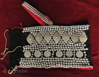 Vintage Indigo Akha Breast Cloth with Tin Embellishments. See more here: https://wovensouls.com/products/309-antique-costume-textiles-akha-blouse