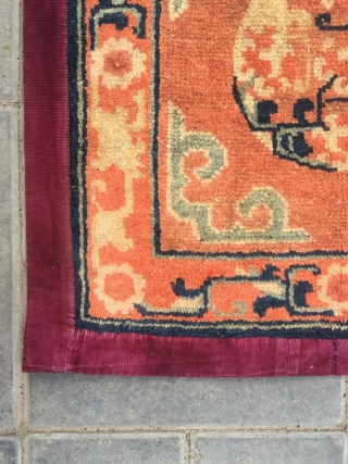"""#2047 Baotou rug, lama sitting mat, orange background with single group flower veins, around  lucky cloud and with flower selvage. Good age and quality. Size 55*55cm(21*21"""")"""