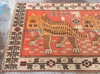 "Xinjiang Khotan rug, red background with two tigers pattern. Good age about 120 years. Size 142*266cm(55*103"")"
