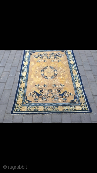 Ningxia carpet, light camel background with single group flower , around with eight lively lions , flower selvage. It was produced in earlier Qing Dynasty. Only have a little wool worn. Good  ...