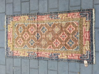 "#2003 Tibet rug, camel background with full of flowers, ""丁"" shape Hui veins selvage symbolize longevity ,rich and good fortune.