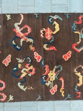 #2008 Tibet rug, it was produced about late Qing Dynasty. The brown background with eight Buddha lucky things. Which are eight kinds of treasures offered by the temples. They are the avatar  ...