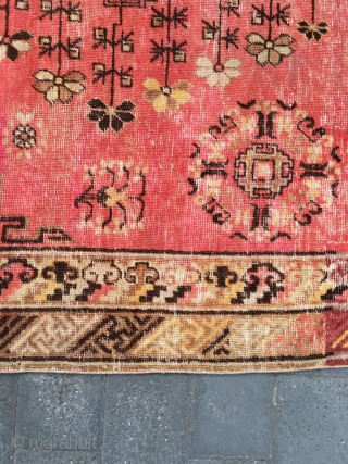 "#1901 Xinjiang carpet, It was produced in Khotan area, red background with "" moon flower""  pattern,which symbolize luck. full of the moon formed with fowers and grass is main part of  ..."