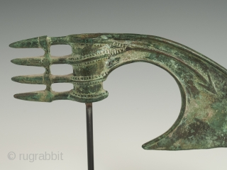 """Axe head, Luristan area, Western Persia. Bronze. c. 1200-800 BC. 3-3/8"""" (8.5 cm) high, 8.25"""" (20.8 cm) wide. This elegant bronze axe head was likely used as a ceremonial weapon. It has  ..."""