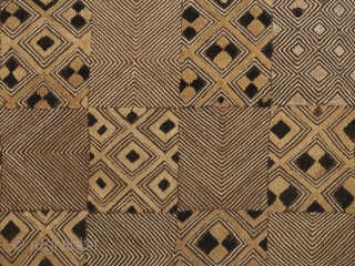 "Cut-pile raffia panel, Shoowa people, a northern group of the Kuba, D.R. Congo. 22.5"" (57 cm) high by 30"" (76.2 cm) wide. Mid-20th century. A fascinating riff on a checkerboard design with  ..."