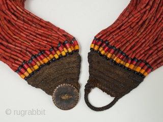 """A nice, full multi-strand beaded necklace, Naga people, Northeastern India. Old glass beads, bronze disc, cotton string, 19"""" (48.2 cm) long. Early to mid-20th century."""