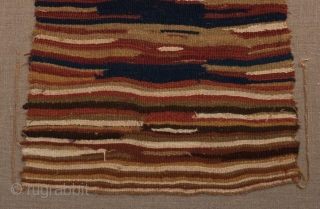 """Pechera (chest panel). Sihuas Valley, Peru. A.D. 200-400. Original condition,  Camelid wool. 28"""" (71 cm) high by 13"""" (33 cm) wide. Professional mount measures 31"""" (79 cm) by 17"""" (43 cm)."""
