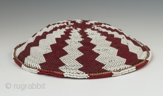 "Zulu beer pot cover ""Imbenge"" made with woven grass covered with very small seed beads. it measures 1.5""(3.3 cm) high x 8"" (20.3 cm) diameter. South Africa. Mid-20th century. Ex. David Roberts.  ..."