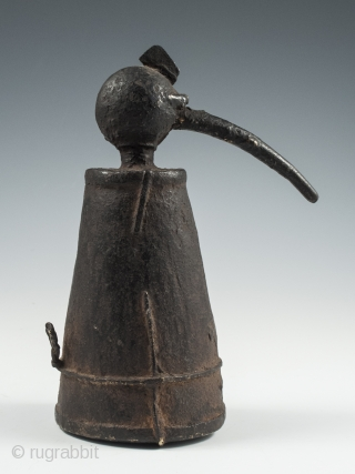 """Iron jeweler's torch, Karnataka, South India, 7"""" (17.7 cm) high, late 19th to early 20th century. These torches often took avian form and this odd bird has quite a unique presence."""