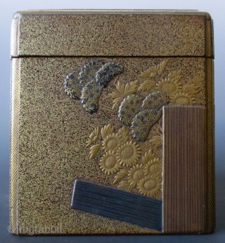 Japanese Antique Gilt Lacquer Kobako with Inside Tray Antique Japanese small kobako (incense box) with inside tray. The outside is decorated with a scene of a garden fence, chrysanthemums, hydrangeas and daisies in  ...
