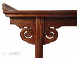 Antique Chinese Hardwood Altar Table  Antique Chinese hardwood altar table with hand carved lingzhi spiral apron joined in upturned flanges. The feet are spanned by an openwork of hand carved panels with drapery  ...