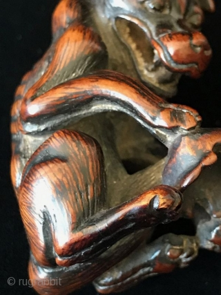 Exceptional Boxwood 18th C. Japanese Yama Inu (Dog) Netsuke   An exceptional antique Japanese bowwood carved netsuke - the Yama Inu - a dog resting his paw on his masters scull. Protecting him in  ...