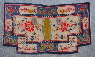 """No.R130 * Antique Tibet Saddle Rug. Age:19th Century. Size: 64 x 113cm (2'1""""x3'8""""). Origin:Tibet. Background Color:Off-whites,lvory.Flower design on an intricate linking """"Eight Buddhist Symbols"""" border."""