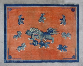 """No.CL036 * Chinese Antique """"Nine lions"""" Rug.Size: 147x182cm(4'10""""x6').Age: Mid-19th CenturyOrigin: Baotou-Suiyuan.Shape: Rectangle.Background Color: Reds. In the centre field a sitting Fo-dog is surrounded by eigh fo-dogs. The lion which is mythological animal has  ..."""